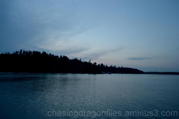 dusk falling over a lake