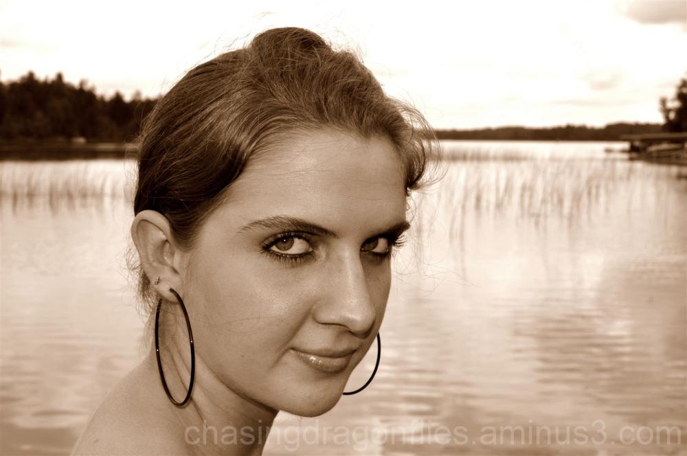 sepia portrait of a girl by lake