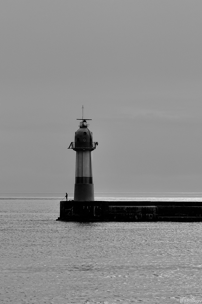 A fisherman by the lighthouse