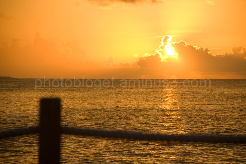 firey orange sunset over the caribbean sea