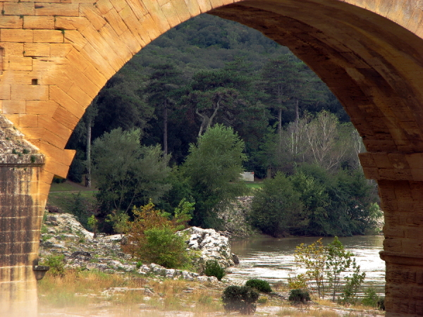 Through one arch of the Pont Du Gard (France)