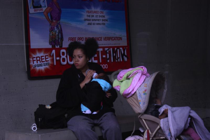 Woman sitting at San Francisco BART station