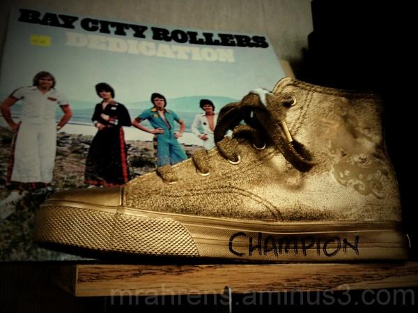 "Golden ""Champion"" shoe and BCR Album"