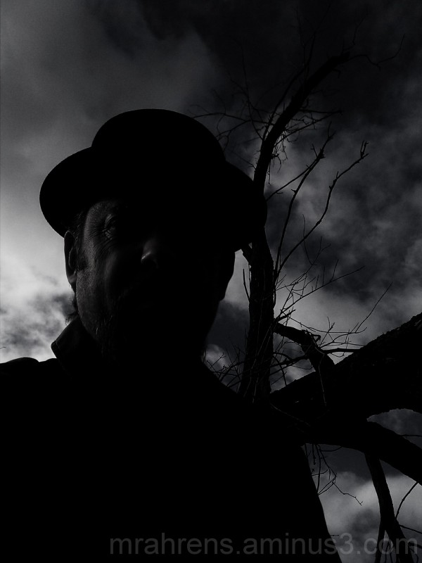 A man in a black hat.