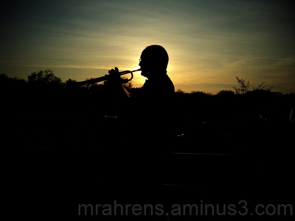 Trumpeter plays to the sunset.