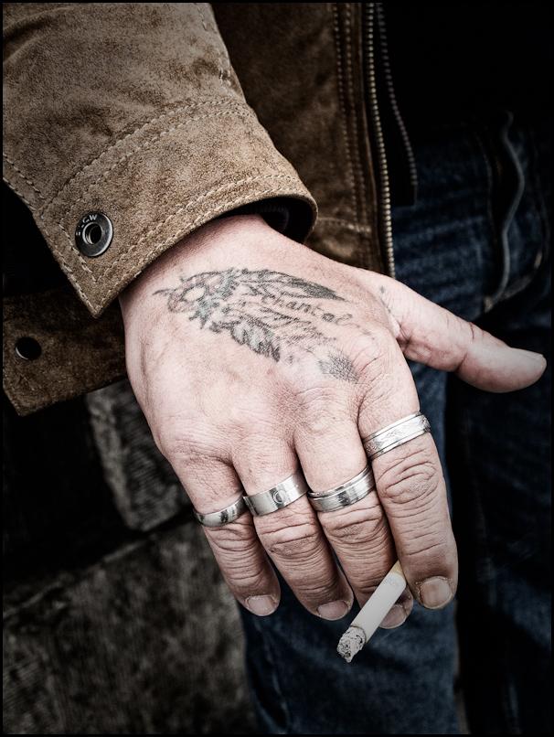 beggar, street photography, cigarette, rings
