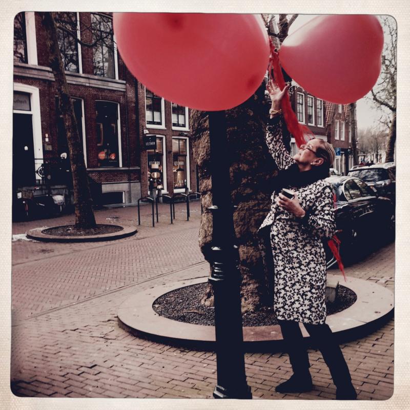 woman balloons street