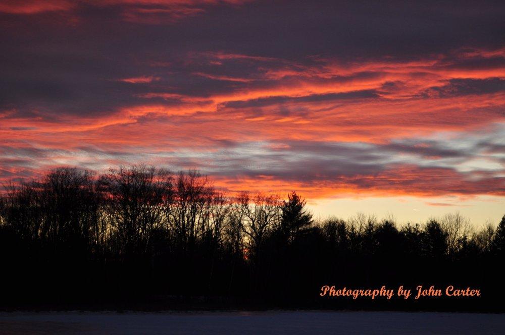 sunset on a frozen lake
