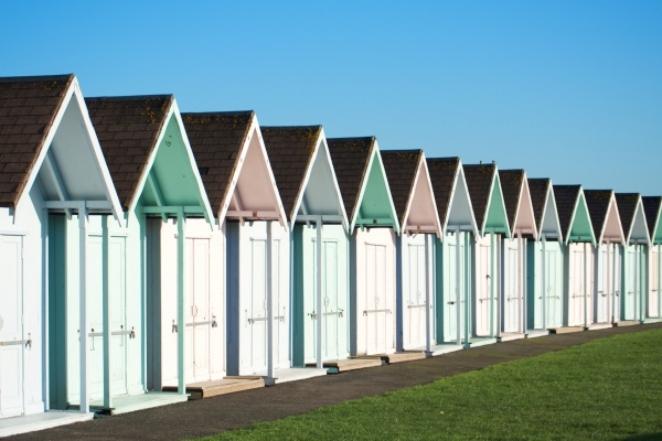 Don't rain on this parade , beach huts in blue sky