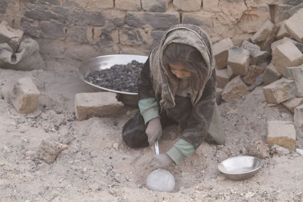 Afghan children collecting Coal from a local brick