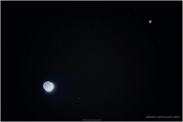 Moon and Venus in Night sky above Glasgow
