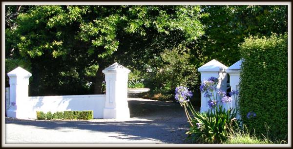 Farmhouse Gates In The Dappled Afternoon Sun