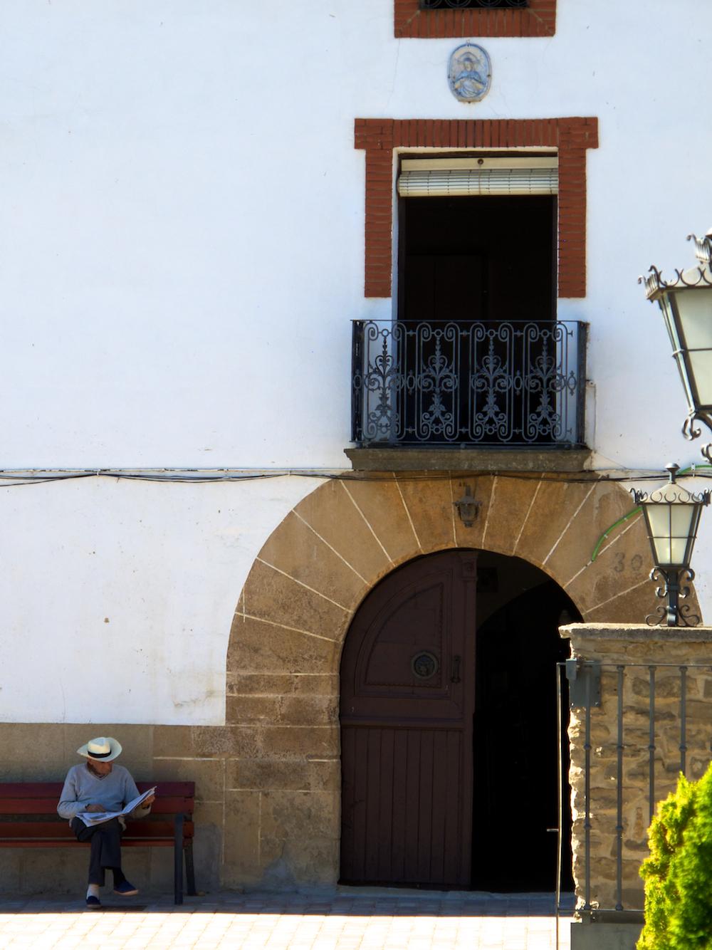Man reading newspaper on Camino, Spain