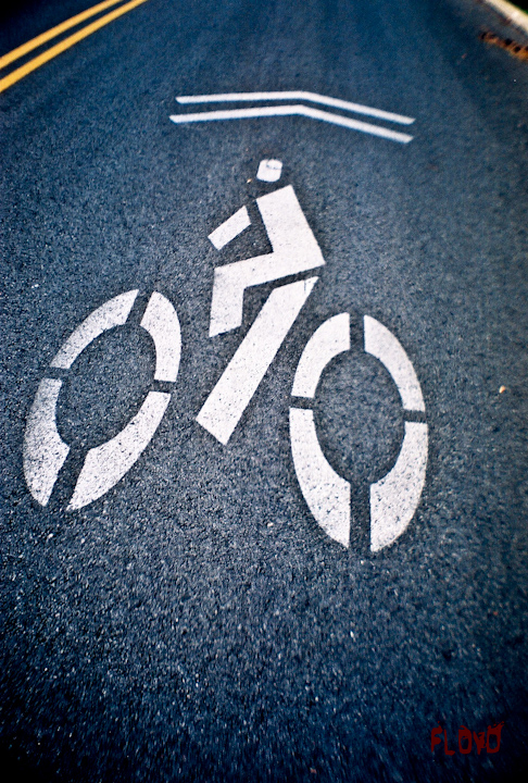 street sign of bicycling