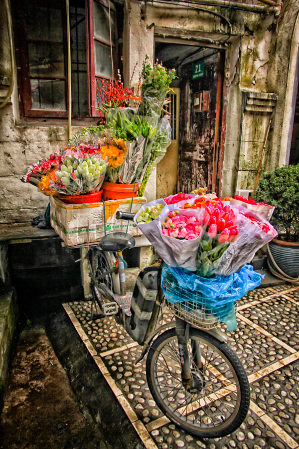 Woman's bicycle loaded with flowers for sale
