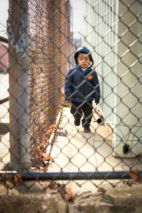 Little boy walking around a playground