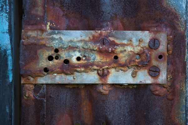 Old decayed hardware to a firedoor