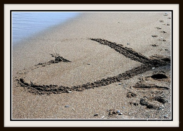 still drawing hearts in the sand
