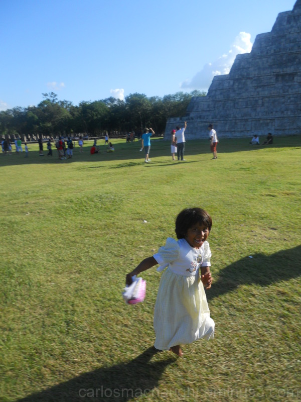Mayan girl running around the pyramid of Chichen I