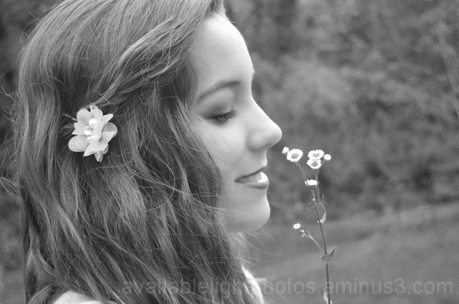 a b&w profile of my sister smelling the flowers.