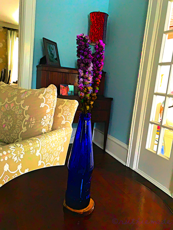Purple Flowers in Blue Vase