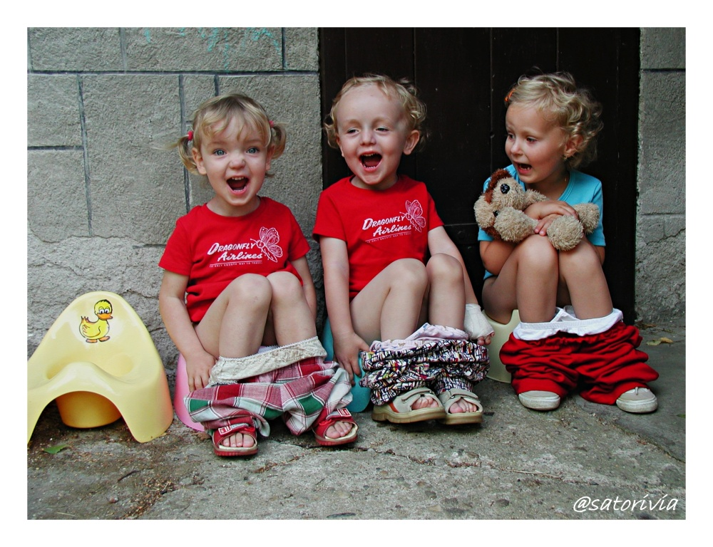 Three little girls yelling
