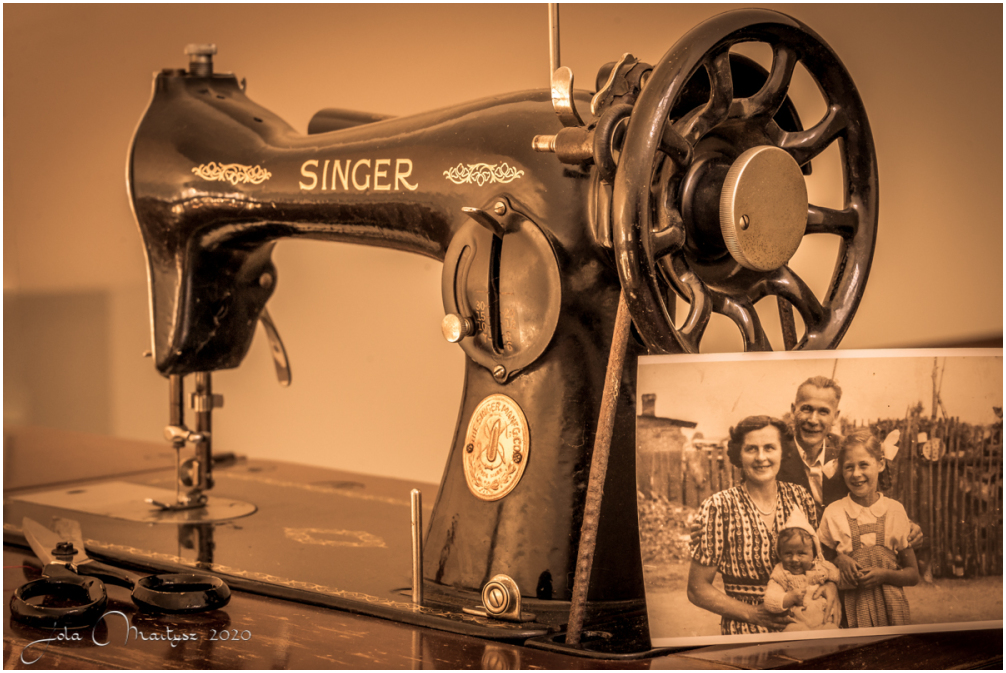 My mother's sewing machine with my family photo.