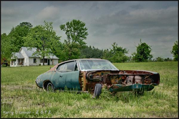this junk car forms a redneck lawn sculpture