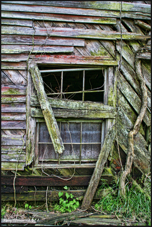 Weathered wood and a broken window