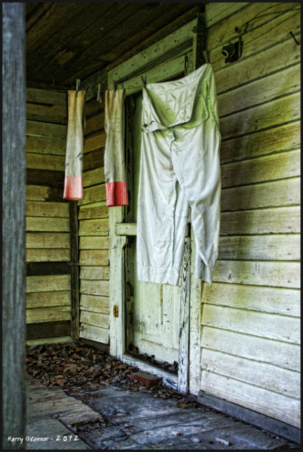 Long johns hanging on a rural clothesline