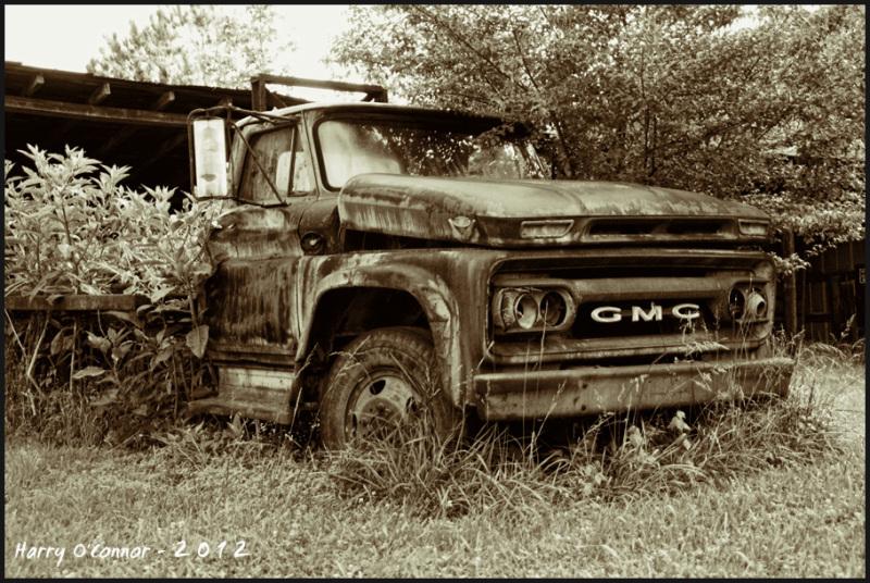 A rusty GMC truck