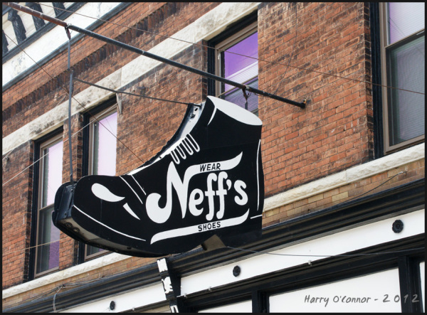 A display sign for Neff's Shoes