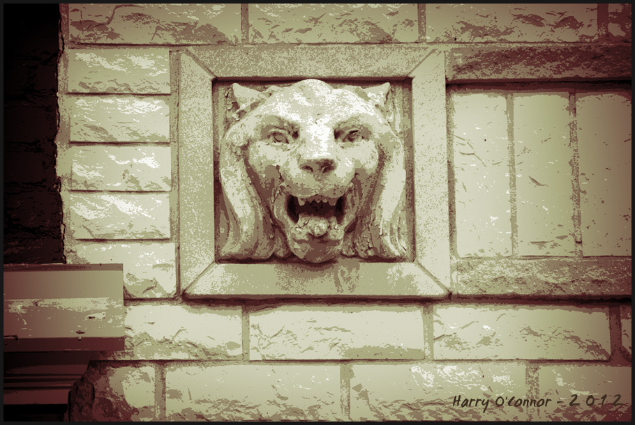 A stone lion's head decorates  early 20th century