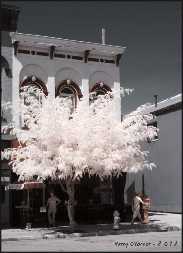 An infrared photo of a street cafe