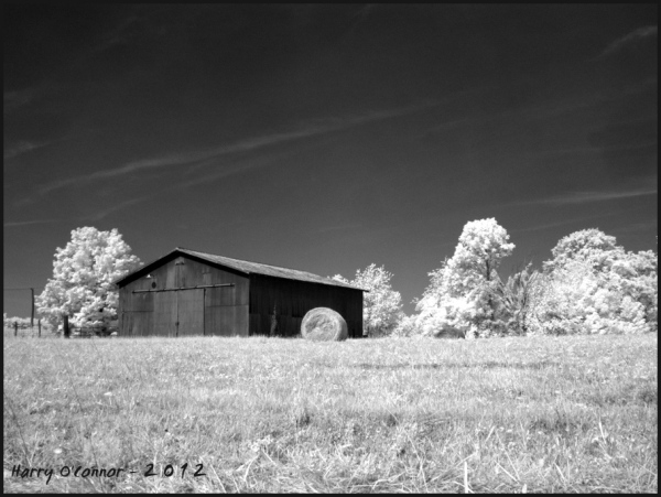 infrared phot of a barn and bale of hay