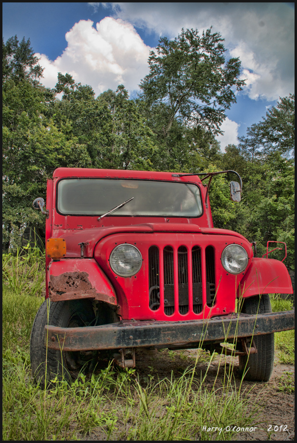 Dinged red Jeep