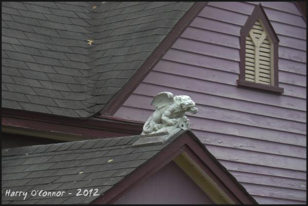 Purple house with gargoyle