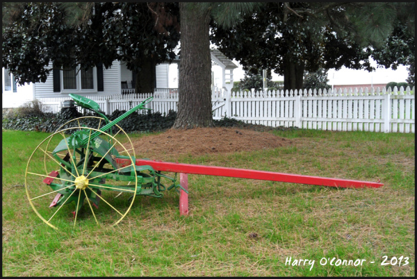 Red yellow & green farm implement