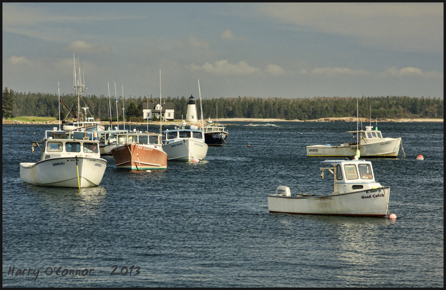 Lobster boats and lighthouse