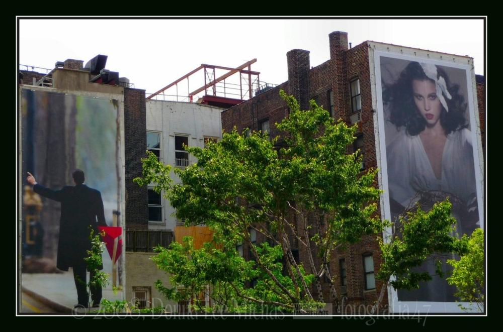 Man & woman on 2 juxtaposed billboards; SoHo, NYC.