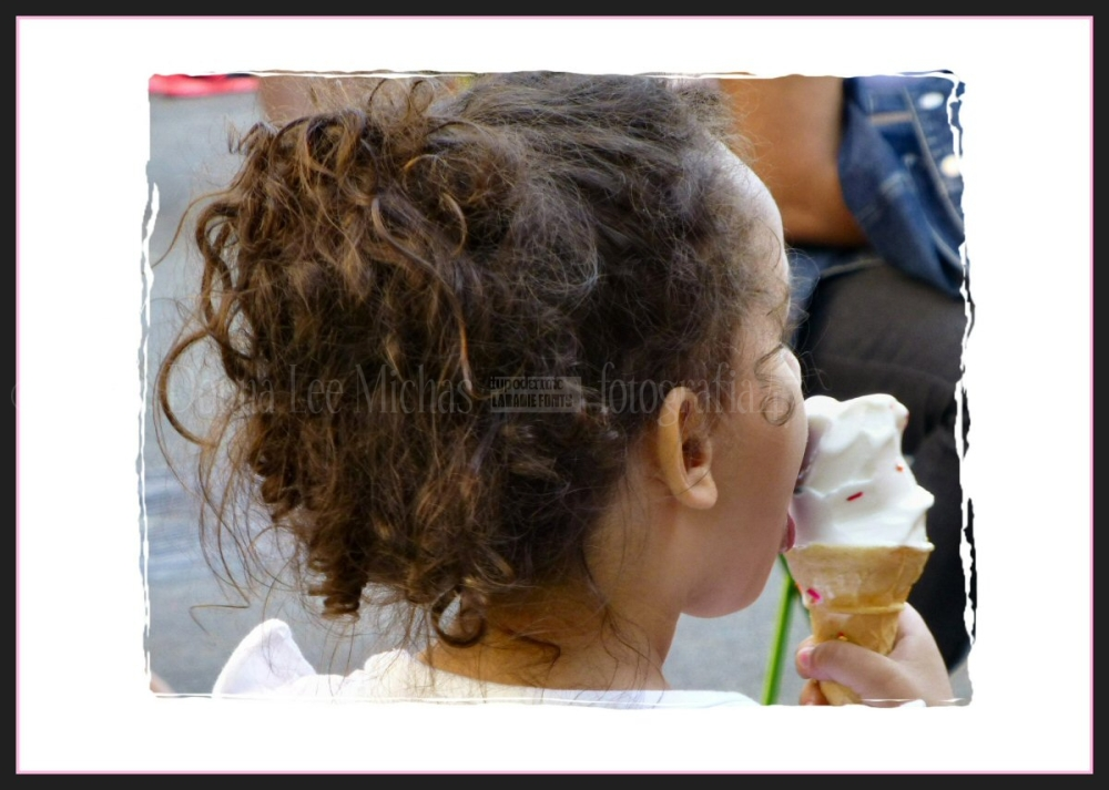 Young girl licking her ice cream cone; Union SQ.