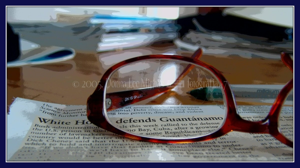 Solarized shot of eyeglasses on a news heading.