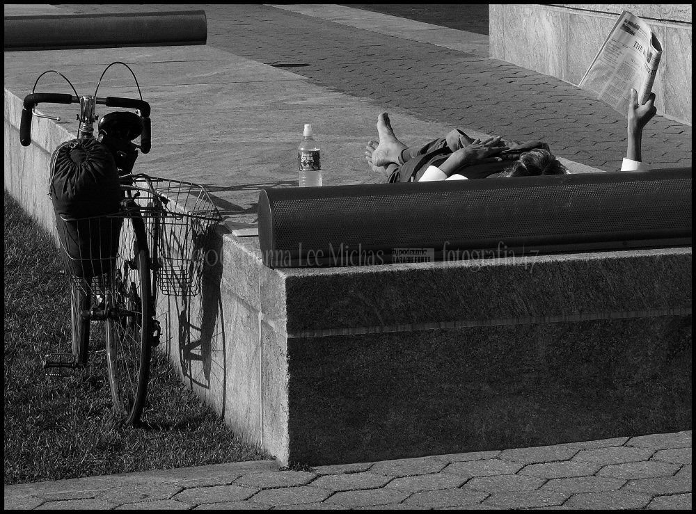 A women biker enjoying the park behind the WFC.