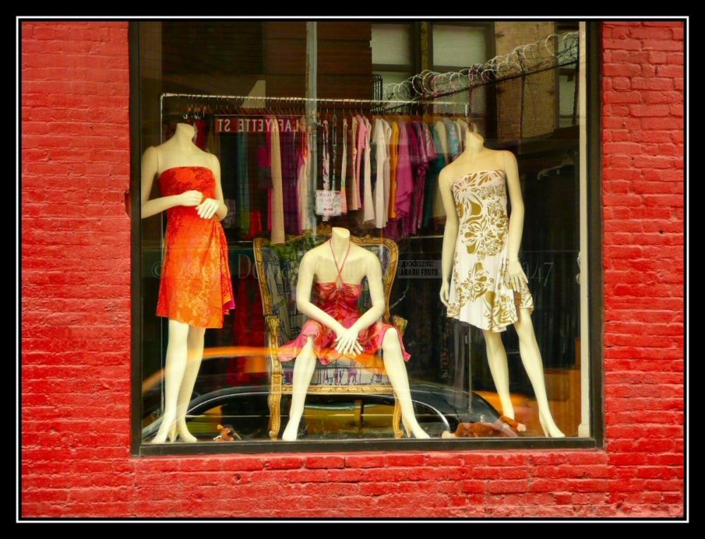Mannequins in window of Victoria Keene's boutique.