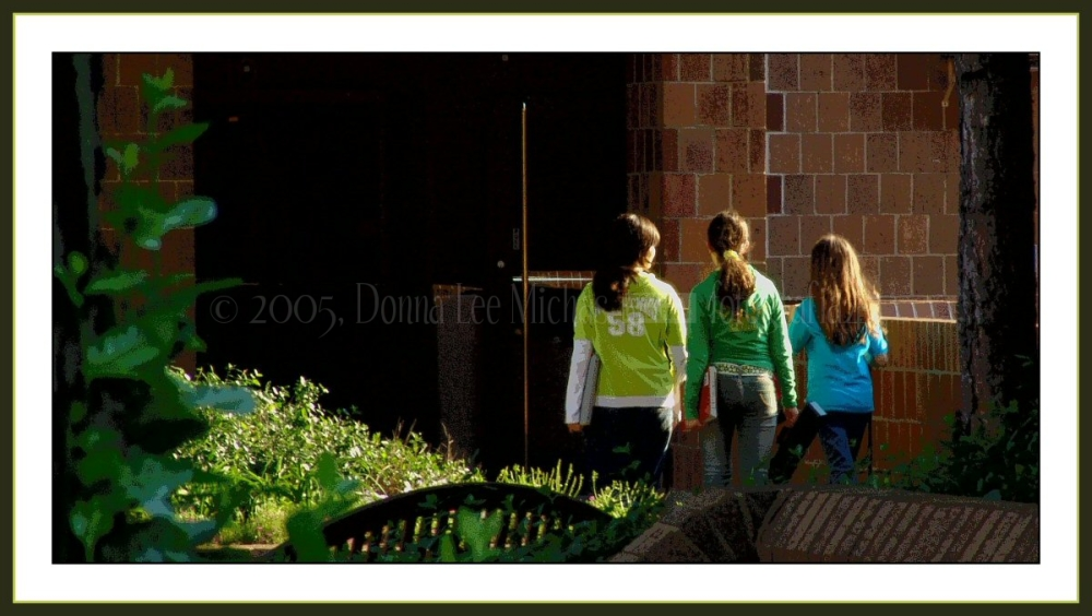 Solarized shot of the back of 3 young girls.