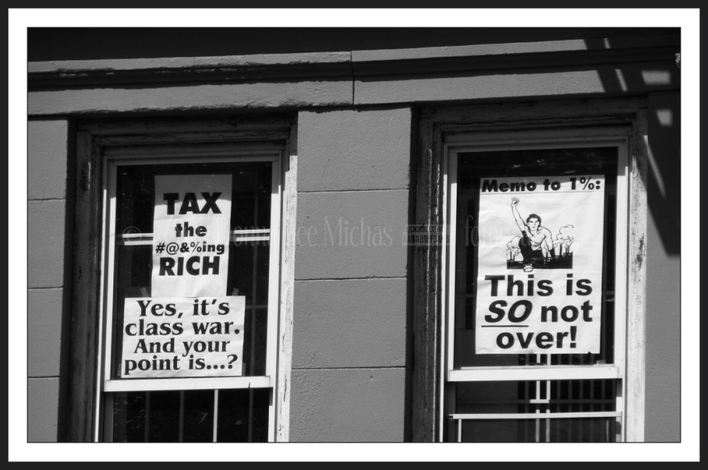 OWS signs in a window on the Lower Eastside.