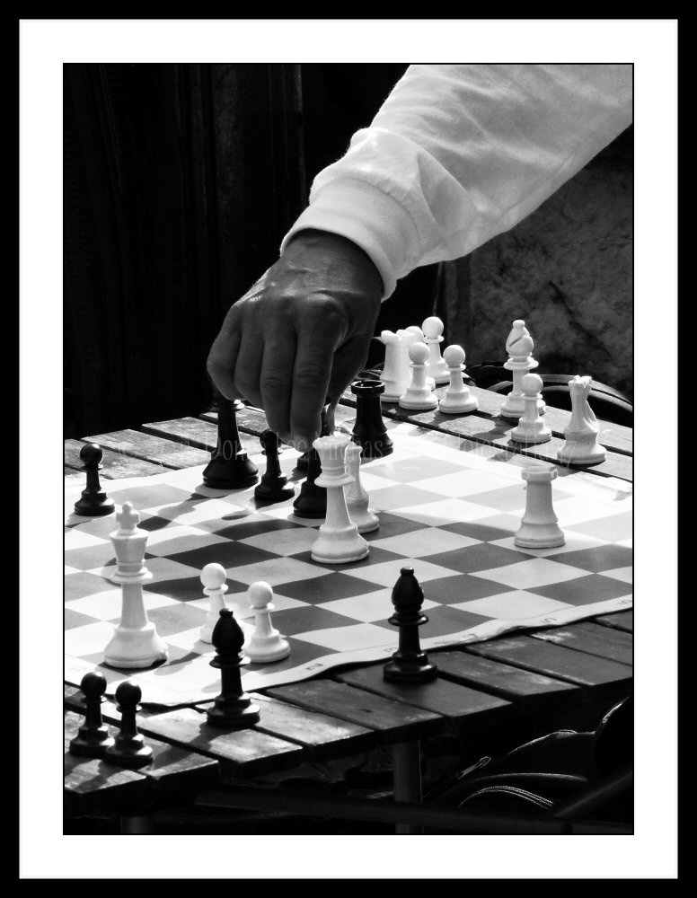 Chess moves in black and white.