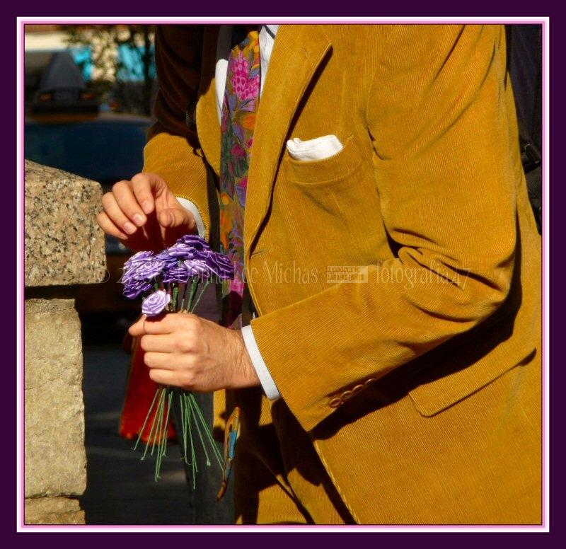 Spiffily attired gentleman choosing a bouquet.