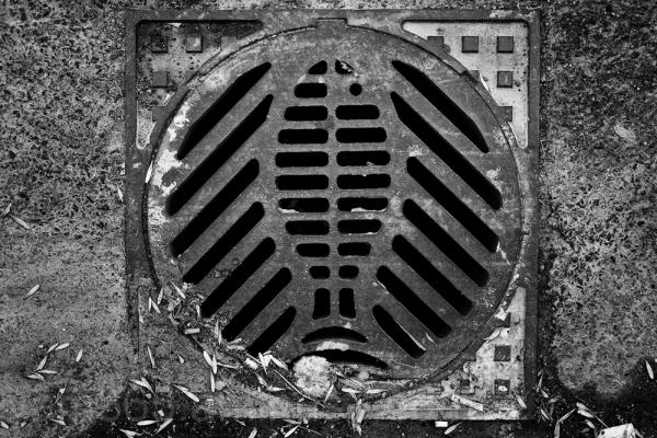 A dirty Ottawa man-hole cover.