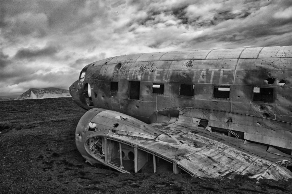 A DC3 Crashed on A Volcanic Beach